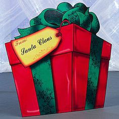 Our Giant Present Standee allows to you to personalize the yellow tag on this large red present accented with a green bow. Each personalized Giant Present Standee is free standing.