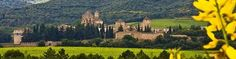 Real Monasterio de Santa Maria de Poblet in Tarragona. One hour south of Barcelona. Has Roman Aquiducts and many Castles. Day trip.