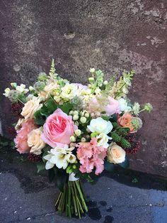 Wedding bouquet with Mayra's bridal pink David Austin roses, spray roses, matthiola, astilbe, hipericum, eustoma (lisianthus). Light pink bridal bouquet.