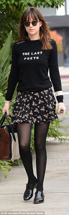 Dressy: With a printed sweater and a floral-print skirt, Dakota had a feminine look...