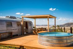 """Camper/RV in Joshua Tree, United States. This is a classic Airstream """"Land Yacht"""" travel trailer, that has been converted into a fully functional guest house. The Land Yacht has its own private deck built alongside it. The deck also supports a large Stock Tank pool, surrounded by bould..."""