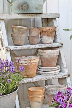 I could do something like this on my ladder! ? Use colorful pots instead?