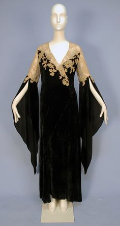 VELVET & LACE DESHABILLE, with wizard sleeves, 1930's. Black bias cut silk panne velvet wrap with off center self button & loop closure, having sheer ecru Alencon lace bodice top & applique to velvet, curved skirt gores, lace topped long, pointed sleeve open from above the elbow, inside tie at waist.