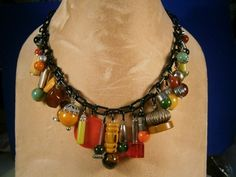 Vintage Genuine BAKELITE BEADS CHARMS on BLACK Celluloid Chain NECKLACE