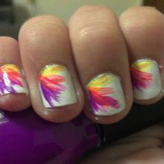 sinful collection yellow, orange, pink, and purple, on white. colors striped on with a paintbrush!