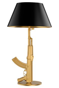 Gun Lamp by Philippe Starck    Designers have the responsibility to re-design negatives into positives.