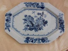 18th Century English London? Delftware Plate Flower basket with Feather pattern could possibly be Liverpool. It is a stunning large plate 33cms long by 24cms across. It has been restored using rivets where it has been broken in 2. £57