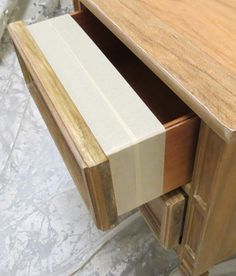 Painting furniture. Talk about an easy way to spray paint drawers and avoid overspray.