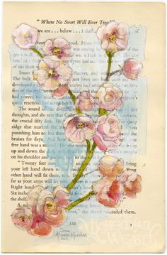 Altered book art with blossoms