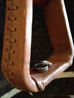 Wedding rings resting in a stirrup