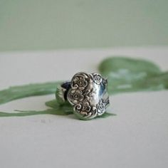 Inspired by an antique silverware pattern from the late 1800's rich in sophisticated detail. The original pattern was revealed during Queen Victoria's rule and features a traditional scallop silhouette. - See more at: http://www.wholesouljewelry.com/silver-spoon-jewelry-lady-helen-spoon-ring/ $32.00