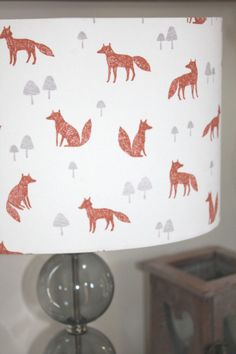 A beautiful lamp shade in this Foxes cotton fabric, designed in Yorkshire and printed in the UK.  Every lamp shade is carefully hand made by Rachel