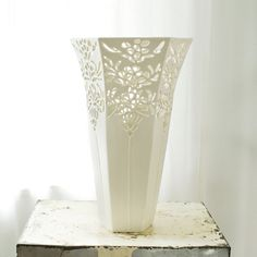 Large hand-carved porcelain vase with lace detail by Isabelle Abramson.