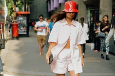 A Guide To Must-Have Summer Essentials From Your Childhood - Pretty In Pink And Red Pink Co Ord Two Piece And Red Patent Leather Bucket Hat Street Style