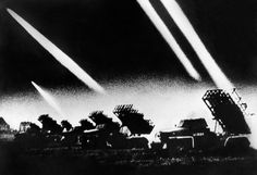 Soviet rocket launchers fire as German forces attack the USSR on June 22, 1941.