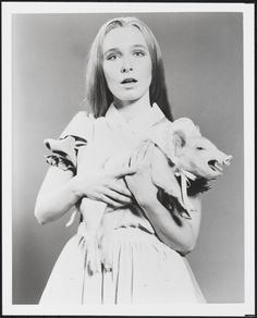 """[Kate Burton as Alice with the pig in """"Alice in Wonderland"""".]"""