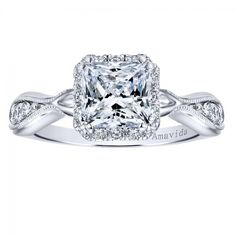 Antique Diamond Halo Engagement Ring, featuring a princess cut diamond.