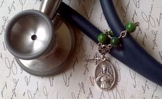 Blessed Stethoscope Charm of Saint Agatha Mini Rosary with Cross for Nurses. $8.75, via Etsy.