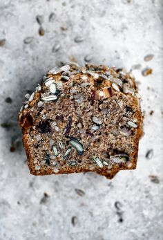 Vegan sunflower seed banana bread with tahini, dates, and seeds. This ultra healthy, grown up olive oil banana bread is packed with good stuff like whole wheat spelt flour and has a phenomenal texture. Sweet Recipes, Whole Food Recipes, Vegan Recipes, Snack Recipes, Cake Recipes, Naan, Spelt Banana Bread, Seed Bread, Vegan Baking