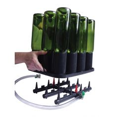 For use with Rinsing & Purging Base. Holds one case of 750 mL or 22 oz bottles at a time. Swing top bottles will fit if the wire swing top is removed. Dimensions: in L x 11 in W x 4 in H