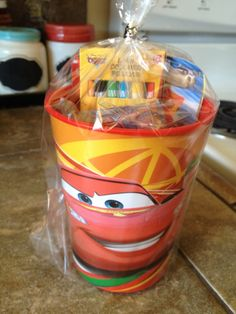 Cars birthday party favor. Plastic cars cup from target filled it with cars crayons, cars notepad, cars stickers, and cars fruit snacks. Super easy and cheap!
