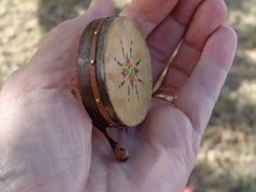 This mini 1/12th scale bodhran has turned out so amazing. I have made it in the traditional way by first steaming the wood until it was pliable, then I wrapped it around several times to give it thickness and strength. The design on the front is hand painted.  https://www.etsy.com/shop/LynnJowers?ref=pr_shop_more