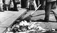 In this picture someone is sweeping up a vast amount of money off the street as it was worthless in Germany during the time the Weimar Republic was active.