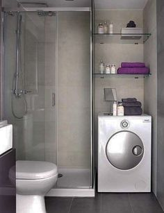Small bathroom with dryer and bits of purple