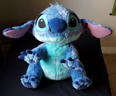 Available is an authentic Disney Parks jumbo Stitch plush from the movie Lilo & Stitch Official Disney theme park merchandise.   eBay!