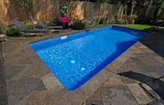 small pool with subtle design elements that borrow from the timeless