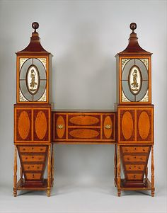 "Desk and Bookcase ca.1811 Mid-Atlantic, Baltimore, Maryland American Mahogany, satinwood, maple, verre, cedar Possibly the most unusual example of high-style furniture in the Federal period. It's design was inspired by the ""Sister's Cylinder Bookcase"", plate 38 in Thomas Sheraton's ""Cabinet Dictionary"" (London, 1803). MET museum"