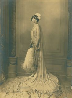 Photograph of Marjorie Merriweather Post taken on the occasion of her presentation at the British Court in 1929. She is shown wearing her Cartier pendant brooch on one hip. See: https://www.facebook.com/HillwoodMuseum/posts/10152222030990847