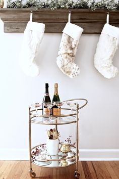 Gold bar cart styling with champagne + gold accents via For All Things Lovely | Easy holiday bar cart + entertaining with Horchow
