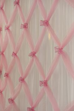 Pretty Party Backdrop.  Tulle gathered with wire edged ribbon bows in front of white sheers.