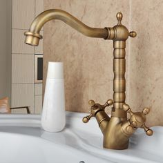 LightInTheBox Antique Inspired Brass Kitchen Faucet (Antique Brass Finish) - Amazon.com. I love this- it looks like happy hands!