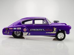 still more  I think I got the paint scheme down on this slot car...1st pic is the 1:1      heres a crazy slot car gasser