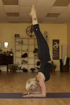 Pincha Mayurasana. I am determined to master this (without the wall) in 2012.