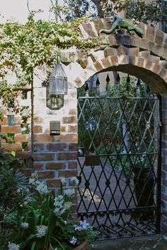 diamond grid iron gate - brick wall - gecko statue over the archway Garden Gates And Fencing, Fence Gate, Front Fence, Brick Fence, Brick Wall, Gate Design, House Design, Garden Entrance, Wrought Iron Fences