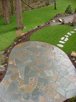 Iron Mountain flagstone patio designed and installed by Blessing Landscapes.