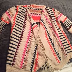 Aztec fringe cardigan Awesome hi low medium weight cardigan in beautiful Aztec print! 3 seasons! Bought from Bohome and worn 2x. Sz m/l. Brand I love. I love Sweaters Shrugs & Ponchos