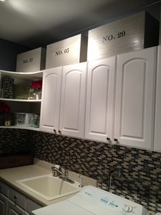 the custom storage crates in their new laundry-room home.  could also be used in an office, study room, playroom, etc.