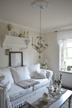 Shabby Chic~~~Lovely white couch and room.  The chandelier is perfect~~