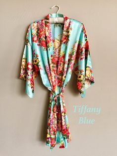Our mint floral bridal robe is a beautiful staple for any wedding day accessory. With a vintage floral pattern throughout, you and your bridesmaids are sure to feel elegant and timeless as you get rea