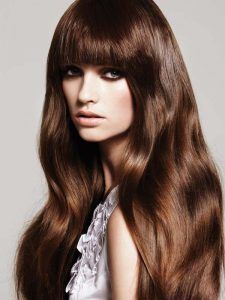 Long brown hairstyles with hazel eye color. Warm brown hair, maybe mahogany.