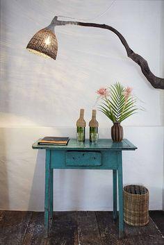 Antique furniture of Casa Terraço do Céu and handmade tree trunk lamp. UXUA, Trancoso, Bahia.