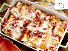 The chorizo and olives in Rachael's Enchiladas give them a Spanish accent. Make the enchiladas ahead and just pop them in the oven come dinnertime.