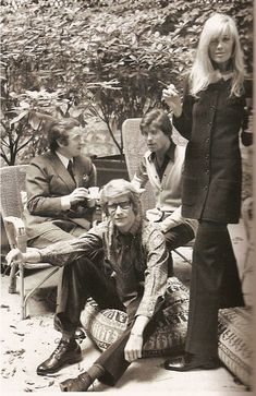 Yves Saint Laurent & Betty Catroux, with Pierre Berge and Francois Catroux behind them.
