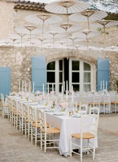 What gorgeous decor for an outdoor wedding reception - floating paper parasols above the table is trés chic, especially when set against a villa backdrop of stone walls and blue shutters. Provence Wedding, Blue Shutters, Outdoor Wedding Reception, Wedding Receptions, Romantic Destinations, French Wedding, Our Wedding Day, Wedding Stuff, Destination Wedding Photographer