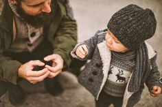 This photo shows a father teaching his son something with his hands. Mothers and Fathers are their to teach their children how to do many things. Children need parents to learn how to walk, talk, among other things. Without parents, children would just be overgrown infants for their whole life. -RM