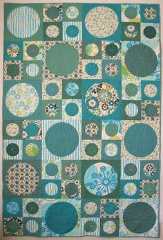 Circles in squares. Different, striking & would work with varying color ways. I can try out the AccuQuilt circle dies.